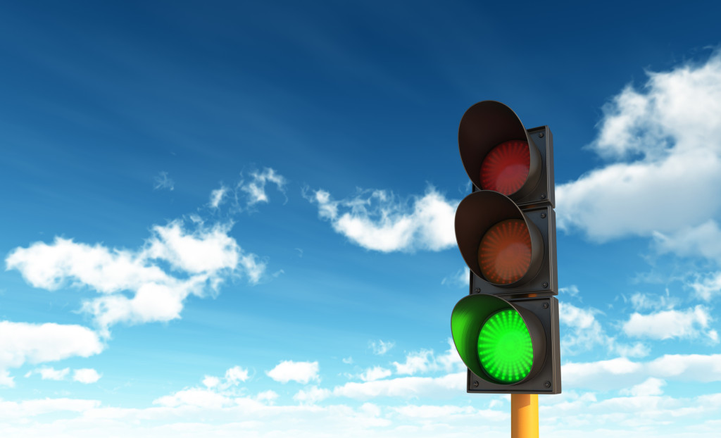 Green Traffic Lights against Blue Sky Backgrounds